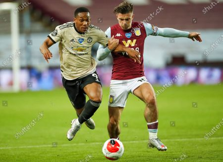 Jack Grealish (R) of Aston Villa in action against Anthony Martial (L) of Manchester United during the English Premier League match between Aston Villa and Manchester United in Birmingham, Britain, 09 July 2020.