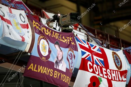 A TV cameraman and flags are seen on the tribune prior to the English Premier League match between Aston Villa and Manchester United in Birmingham, Britain, 09 July 2020.