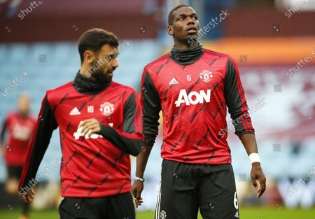 Manchester United's Bruno Fernandes (L) and Paul Pogba warm up prior to the English Premier League match between Aston Villa and Manchester United in Birmingham, Britain, 09 July 2020.