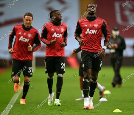 Manchester United's Paul Pogba, (R), warms up with teammates Aaron Wan-Bissaka (C) and Nemanja Matic (L) prior to English Premier League soccer match between Aston Villa and Manchester United in Birmingham, Britain, 09 July 2020.