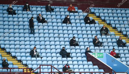 The journalist keep social distance on the tribune prior to the English Premier League match between Aston Villa and Manchester United in Birmingham, Britain, 09 July 2020.