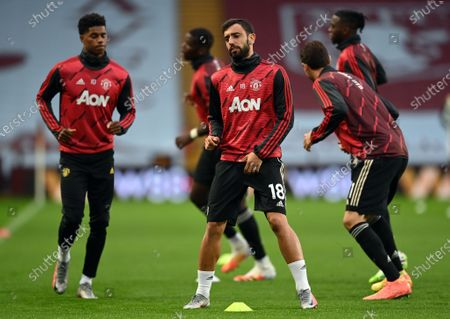 Manchester United's Bruno Fernandes (P), warms up with teammates prior to English Premier League soccer match between Aston Villa and Manchester United in Birmingham, Britain, 09 July 2020.