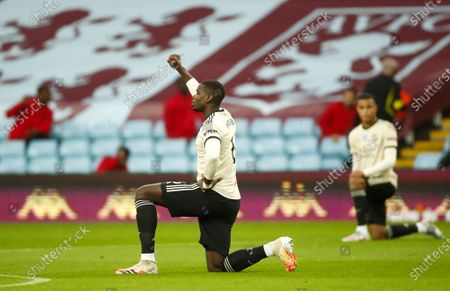 Paul Pogba of Manchester United takes a knee to support the Black Lives Matters movement ahead of the English Premier League match between Aston Villa and Manchester United in Birmingham, Britain, 09 July 2020.