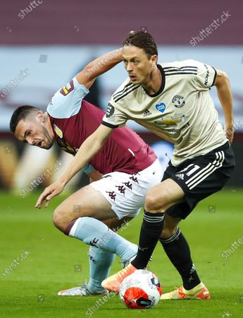 John McGinn (L) of Aston Villa in action against Nemanja Matic (R) of Manchester United during the English Premier League match between Aston Villa and Manchester United in Birmingham, Britain, 09 July 2020.