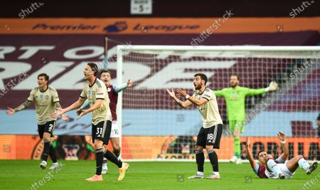 Manchester United's players react during the English Premier League match between Aston Villa and Manchester United in Birmingham, Britain, 09 July 2020.