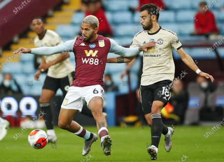 Douglas Luiz (L) of Aston Villa in action against Bruno Fernandes (R) of Manchester United during the English Premier League match between Aston Villa and Manchester United in Birmingham, Britain, 09 July 2020.