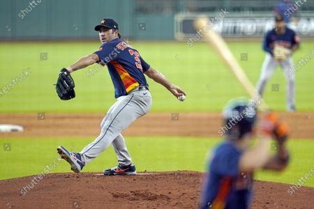 Houston Astros pitcher Justin Verlander, left, throws to Jose Altuve during a simulated baseball game, in Houston