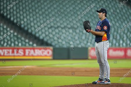 Houston Astros pitcher Justin Verlander prepares to throw during a simulated baseball game, in Houston