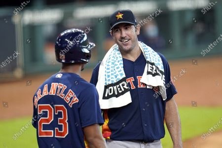 Houston Astros pitcher Justin Verlander, right, talks with Michael Brantley (23) after throwing during a simulated baseball game, in Houston