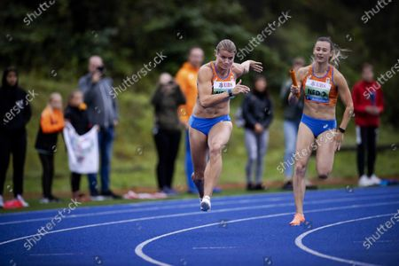 Dafne Schippers (L) and Nadine Visser of the Netherlands compete in the women's 3 x 100 meter relay race during the Inspiration Games, a virtual international athletics meeting at seven venues worldwide, at Papendal in Arnhem, The Netherlands, 09 July 2020.