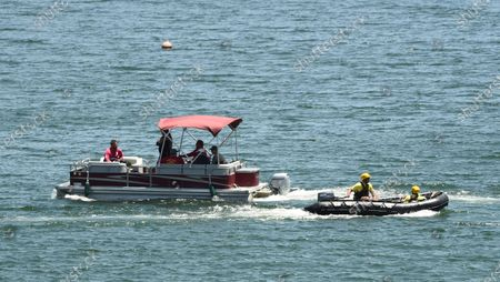 """Members of Ventura County Sheriff's Office Underwater Search and Rescue Team search for former """"Glee"""" actress Naya Rivera, in Lake Piru, Calif. Rivera rented a boat on Wednesday and her 4-year-old son was found alone on the rented boat"""