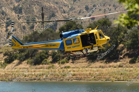 """Ventura County Sheriff's Office helicopter searches for former """"Glee"""" actress Naya Rivera, in Lake Piru, Calif. Rivera rented a boat on Wednesday and her 4-year-old son was found alone on the rented boat"""
