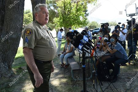 """Sgt. Kevin Donoghue, of the Ventura County Sheriff's Department, addresses the media during a press conference as members of his department's Underwater Search and Rescue Team search for former """"Glee"""" actress Naya Rivera, in Lake Piru, Calif. Rivera rented a boat on Wednesday and her 4-year-old son was found alone on the rented boat"""