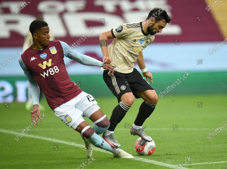 Image libre de droits de Manchester United's Bruno Fernandes, right, is tackled by Aston Villa's Ezri Konsa during the English Premier League soccer match between Aston Villa and Manchester United at Villa Park in Birmingham, England