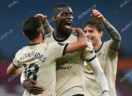 Manchester United's Paul Pogba, centre, celebrates with teammates after scoring his team's third goal during the English Premier League soccer match between Aston Villa and Manchester United at Villa Park in Birmingham, England