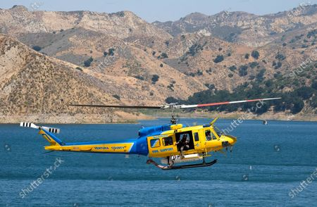 """Ventura County sheriff's helicopter helps in the search for former """"Glee"""" actress Naya Rivera, at Lake Piru in Los Padres National Forest, northwest of Los Angeles. Rivera rented a boat Wednesday and her 4-year-old son was found alone on the boat"""
