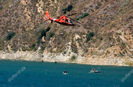 """Helicopter helps in the search for former """"Glee"""" star Naya Rivera, at Lake Peru in Los Padres National Forest, northwest of Los Angeles"""