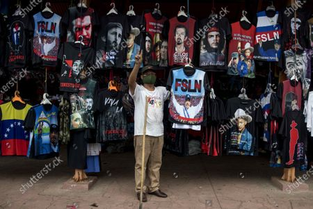 A man sells shirts on the occasion of the 41st anniversary of the Sandinista revolution, in Managua, Nicaragua, 09 July 2020. The Government of Daniel Ortega has suspended the traditional mass event that the Sandinistas celebrate for the anniversary of the revolution, every 19 July. Opposition politician Eliseo Núñez, stated it is a 'tacit recognition' that the COVID-19 pandemic exceeds the narrative that the Government of Daniel Ortega has wanted to sell' and that is 'an enormous crisis of credibility'.