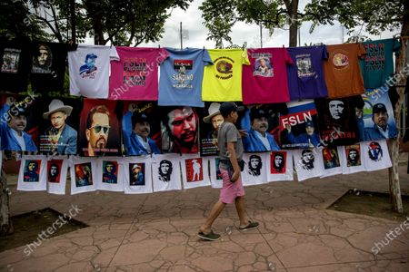A child walks next to shirts on sale on the occasion of the 41st anniversary of the Sandinista revolution, in Managua, Nicaragua, 09 July 2020. The Government of Daniel Ortega has suspended the traditional mass event that the Sandinistas celebrate for the anniversary of the revolution, every 19 July. Opposition politician Eliseo Núñez, stated it is a 'tacit recognition' that the COVID-19 pandemic exceeds the narrative that the Government of Daniel Ortega has wanted to sell' and that is 'an enormous crisis of credibility'.