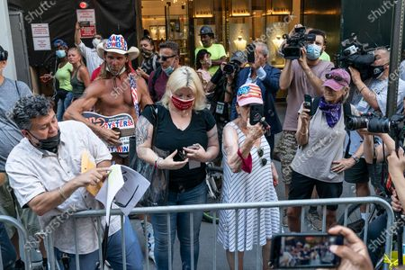 Trump supporters including Naked Cowboy from Times Square showing displeasure with Mayor Bill De Blasio, Al Sharpton & volunteers paint Black Lives Matter mural on 5th Avenue in front of Trump Tower. Trump Tower was the headquarter of President 2016 election campaign and he own apartment in that building. President Trump blasted Black Lives Matter as a â€oesymbol of hateâ€� on July 8, 2020 and claimed the city would ruin the â€oeluxuryâ€� of Midtown by painting a mural of the famous rallying cry in front of his most prized skyscraper.