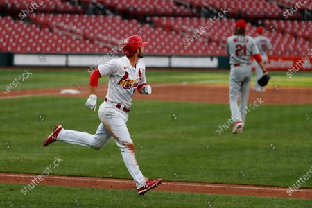 St. Louis Cardinals' Paul DeJong, left, rounds the bases after hitting a two-run home run off pitcher Andrew Miller (21) during an intrasquad practice baseball game at Busch Stadium, in St. Louis