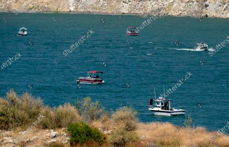 """Members of Ventura County Sheriff's Office Underwater Search and Rescue Team search for former """"Glee"""" actress Naya Rivera, at Lake Piru in Los Padres National Forest, northwest of Los Angeles. Rivera rented a boat Wednesday and her 4-year-old son was found alone on the boat"""