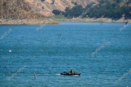 """Members of the Ventura County Sheriff's Office in a boat search for former """"Glee"""" actress Naya Rivera, in Lake Piru, Calif. Rivera rented a boat on Wednesday and her 4-year-old son was found alone on the rented boat"""