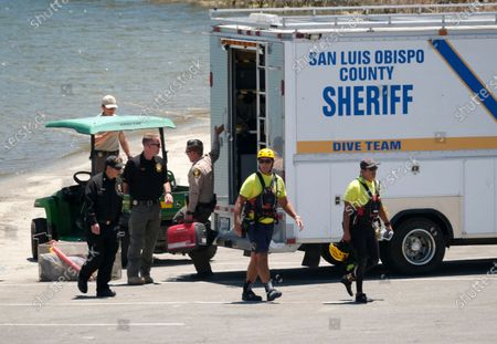 """Members of Ventura County Sheriff's Office Underwater Search and Rescue Team help in the search for former """"Glee"""" star Naya Rivera, in Lake Piru, Calif"""