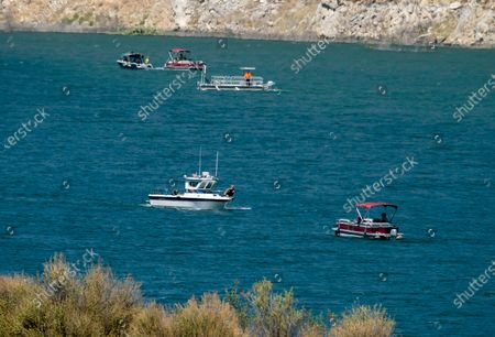 """Members of Ventura County Sheriff's Office Underwater Search and Rescue Team in the search for former """"Glee"""" actress Naya Rivera, at Lake Piru in Los Padres National Forest, northwest of Los Angeles. Rivera rented a boat Wednesday and her 4-year-old son was found alone on the boat"""
