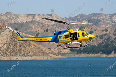 """Helicopter helps in the search for former """"Glee"""" actress Naya Rivera, at Lake Piru in Los Padres National Forest, northwest of Los Angeles. Rivera rented a boat Wednesday and her 4-year-old son was found alone on the boat"""