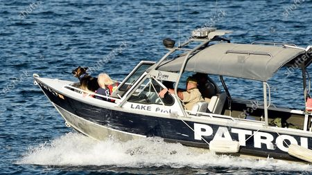Patrol boat with a search and rescue dog heads out on Lake Piru Reservoir, in Ventura, Calif. Authorities said Thursday that they believe Rivera drowned in a Southern California lake but they are continuing the search for her a day after her 4-year-old son was found alone in a rented boat