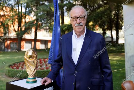 Former Spanish national soccer team head coach Vicente del Bosque poses next to the FIFA World Cup trophy during an event to commemorate the 10th anniversary of Spain's victory at the 2010 FIFA World Cup in Madrid, Spain, 10 July 2020. Spain defeated the Netherlands 1-0 after extra time in the 2010 FIFA World Cup final at Soccer City Stadium in Johannesburg, South Africa on 11 July 2010.