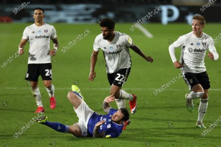 Craven Cottage, London, England; Cyrus Christie of Fulham fouls Lee Tomlin of Cardiff City; English Championship Football, Fulham versus Cardiff City.