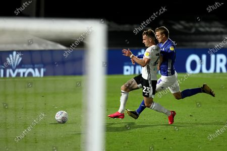 Craven Cottage, London, England; Joe Bryan of Fulham competes for the ball with Danny Ward of Cardiff City; English Championship Football, Fulham versus Cardiff City.