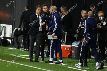 Craven Cottage, London, England; Fulham Manager Scott Parker shakes hands with the Cardiff City bench after the 2; English Championship Football, Fulham versus Cardiff City.