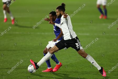 Craven Cottage, London, England; Michael Hector of Fulham competes for the ball with Nathaniel Mendez; English Championship Football, Fulham versus Cardiff City.