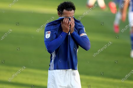 Craven Cottage, London, England; Sean Morrison of Cardiff City covers his face with his shirt as a chance goes begging; English Championship Football, Fulham versus Cardiff City.