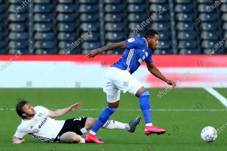 Craven Cottage, London, England; Harry Arter of Fulham slide tackles Nathaniel Mendez; English Championship Football, Fulham versus Cardiff City.