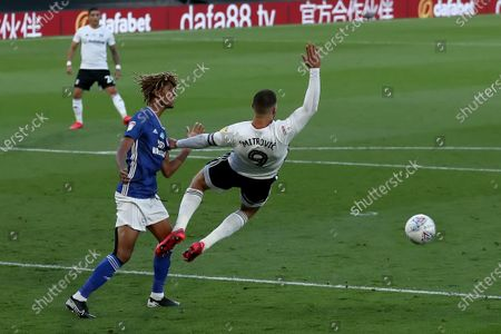 Craven Cottage, London, England; Dion Sanderson of Cardiff City pulls down Aleksandar Mitrovic of Fulham and gives away a penalty in the 35th minute; English Championship Football, Fulham versus Cardiff City.