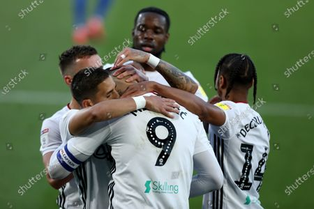 Craven Cottage, London, England; Aleksandar Mitrovic of Fulham celebrates with team mates after he scores from the penalty spot for 1; English Championship Football, Fulham versus Cardiff City.