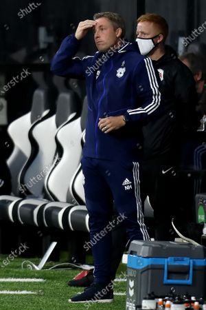 Craven Cottage, London, England; Cardiff City Manager Neil Harris holds his head as his team lag behind in the 2nd half; English Championship Football, Fulham versus Cardiff City.
