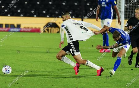 Joe Ralls of Cardiff City is booked for pulling the shirt of Aleksander Mitrovic of Fulham