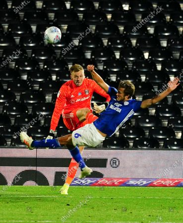 Goalkeeper Marek Rodak of Fulham clears under pressure from Will Vaulks of Cardiff City