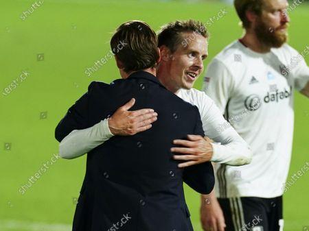 Stefan Johansen of Fulham hugs Fulham Manager Scott Parker after the 2-0 win