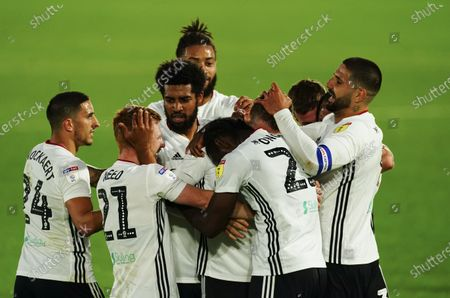 Josh Onomah of Fulham is mobbed after scoring the second goal