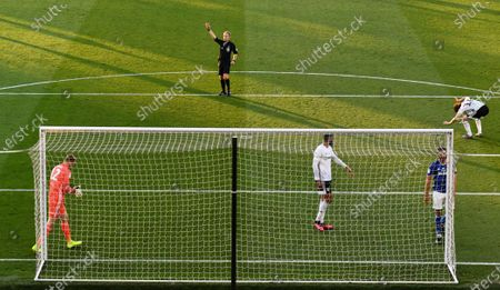 Harry Arter of Fulham hits the ground, right, as the referee signals for a corner-kick