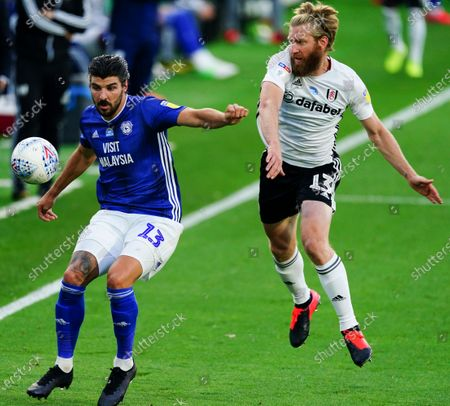 Tim Ream of Fulham battles with Callum Paterson of Cardiff City