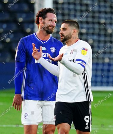 Aleksander Mitrovic of Fulham chats to Sean Morrison of Cardiff City after he scored the opening coal