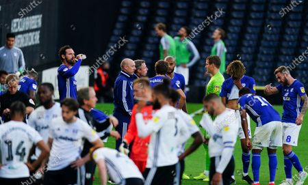 Cardiff City manager Neil Harris talks to his players during the first half drinks break