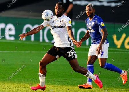 Josh Onomah of Fulham controls ahead of Leandro Bacuna of Cardiff City